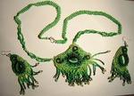 """Комплект бижутерии под названием  """"Кикимора """": кулон и серьги с кабошонами, обшитыми..."""